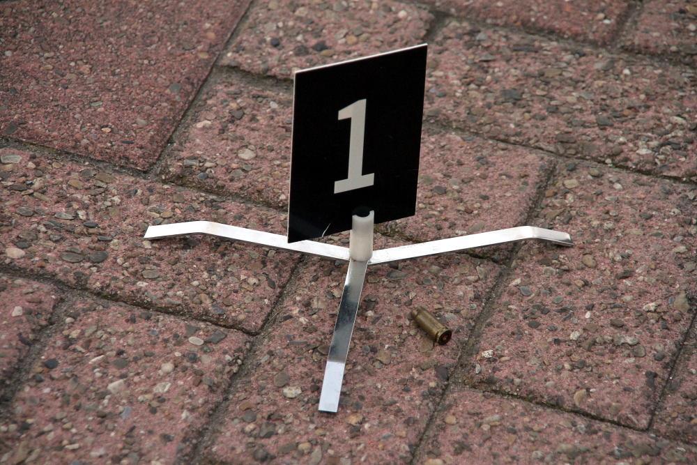 Foto van kogel huls bordje | Archief Flashphoto.nl | www.flashphoto.nl