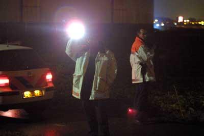 Foto van politie met zaklamp   Archief EHF