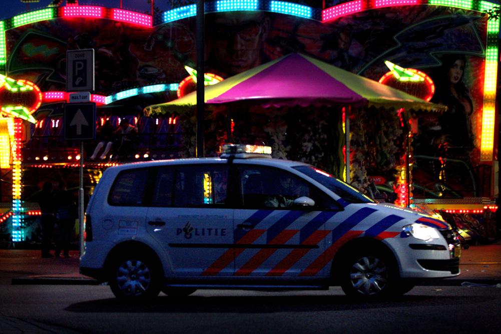 Foto van politieauto kermis donker | Archief EHF