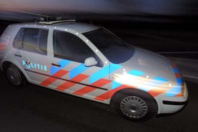 Foto van politieauto in donker   Archief EHF