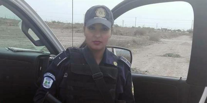 Agente geschorst om topless foto in uniform