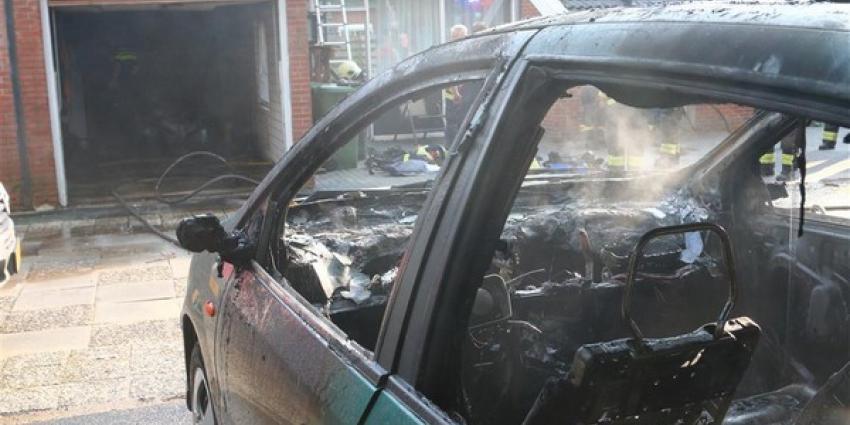 Autobrand in garage met gasflessen
