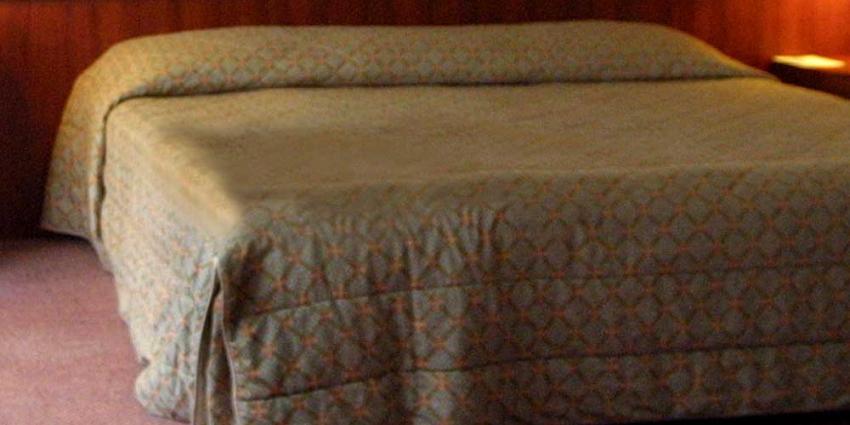 Foto van bed in hotelkamer | Archief EHF