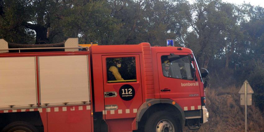 Toeristen op de vlucht voor bosbranden in Frankrijk en Spanje