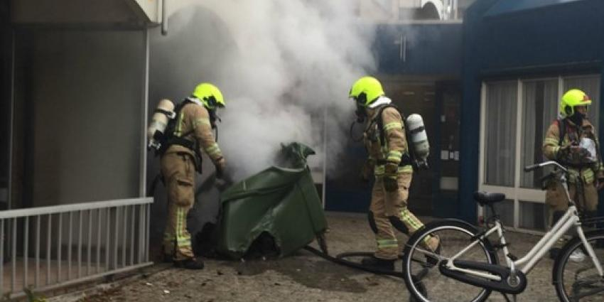 Middelbrand door brand in container