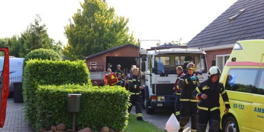 Man bekneld onder tractor in Buinen