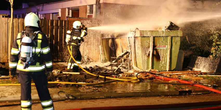 Bouwcontainer tegen gevel in brand woning Den Bosch