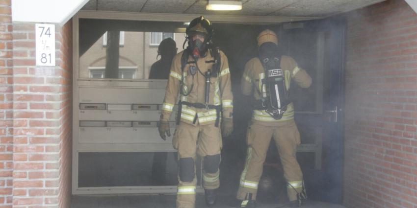 Portiek vol rook door keukenbrand