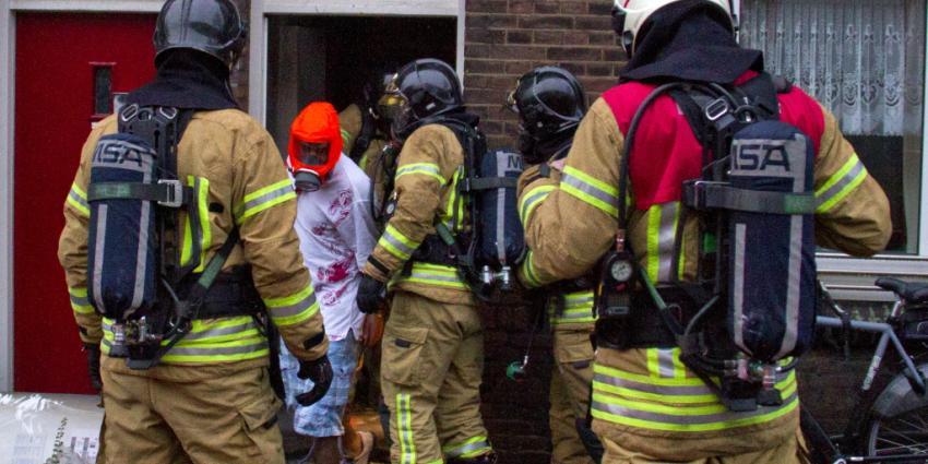 Man gered uit woning na brand