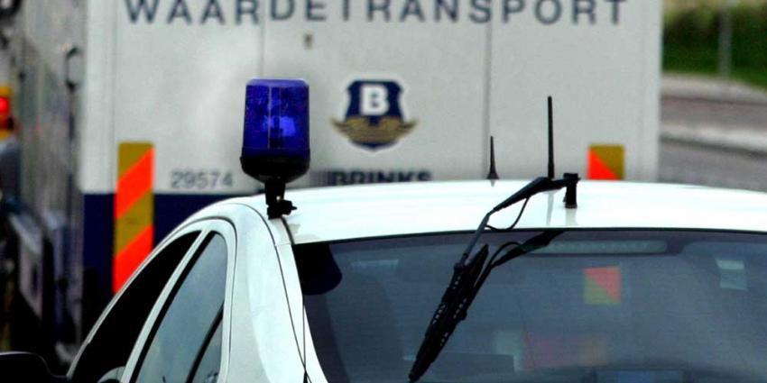 Foto van geldtransport en politieauto | Archief EHF