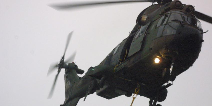 Lichaam piloot die op grote hoogte uit helikopter viel gevonden