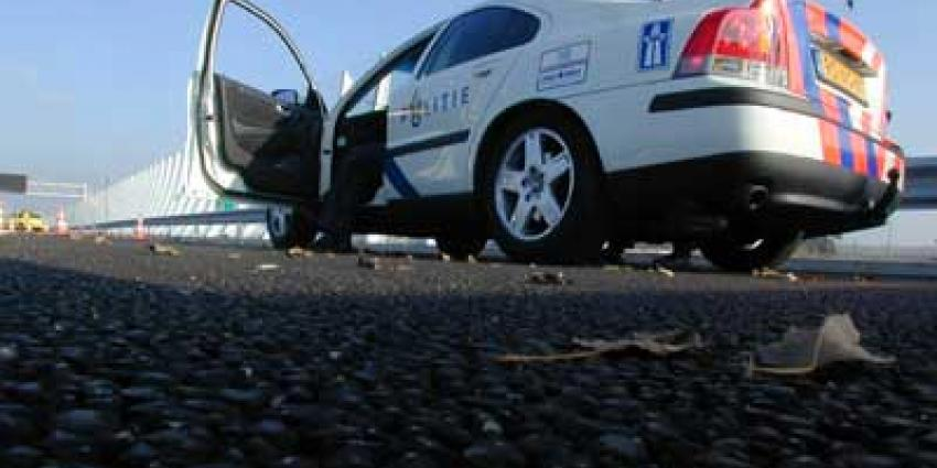 Foto van politieauto op vluchtstrook snelweg | Archief EHF