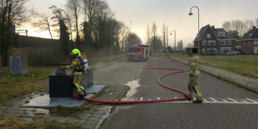 Ondergrondse container in brand gestoken