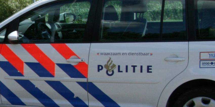 Bromfietsster gewond na aanrijding politieauto