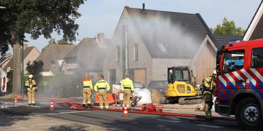 brandweer zet waterscherm in