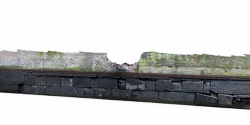 Gedeelte middeleeuwse stadsmuur in Amsterdam ontdekt