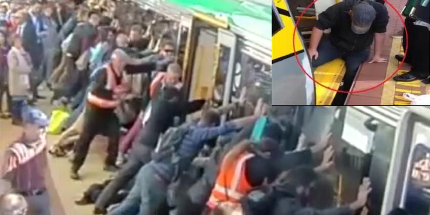 Passagiers kantelen treinstel om met been beknelde man te bevrijden