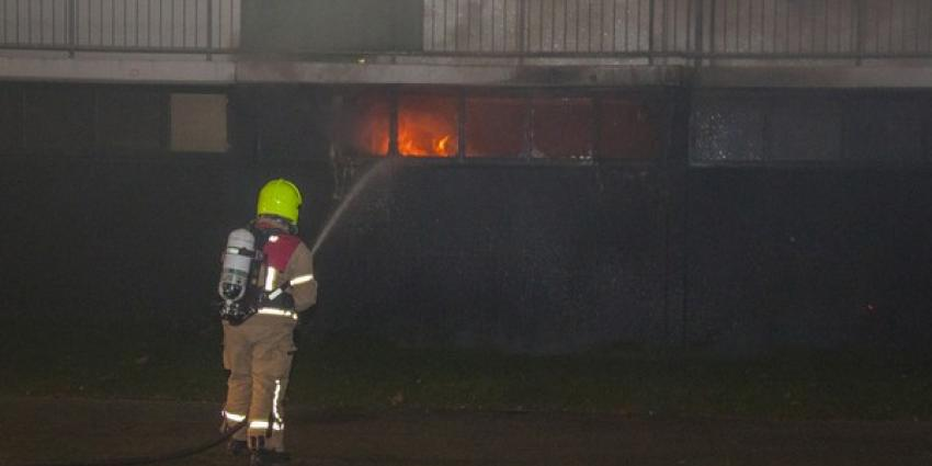 Uitslaande brand in kelderbox van flatgebouw Maassluis