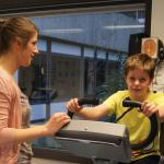 Kind op hometrainer