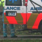 Foto van agent bij ambulance   Archief EHF