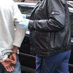 Foto van arrestant in handboeien politie | Archief EHF