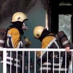 Foto van brandweer op galerij flat | Archief EHF
