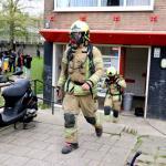 Kinderwagen in brand in flat