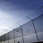 Foto van hek rond detentie-inrichting | Archief EHF
