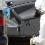 Foto van forensisch onderzoek bij auto | Archief EHF