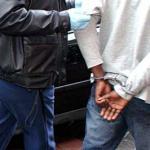 Foto van verdachte met handboeien | Archief EHF