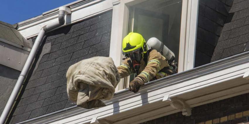 Brandweer blust brandje in bed