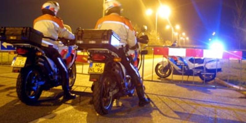 Foto van politie motoren donker zwaailicht   Archief EHF