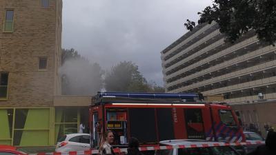 Rook uit flatwoning in Groningen