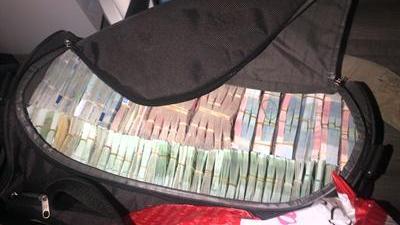Foto van koffer vol met geld   Landelijk Parket