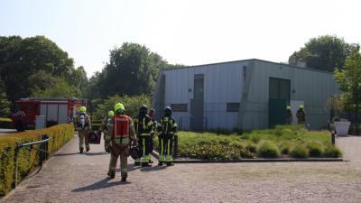 Foto van brandweer bij crematorium