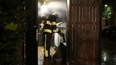 Afvalcontainer in containerhok in brand Bracbant Boxtel