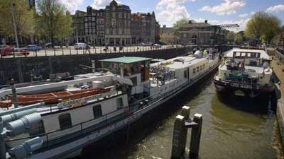 Foto van woningen aan Amsterdamse gracht | Archief EHF