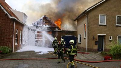 Brand in garage van woning in Schijndel