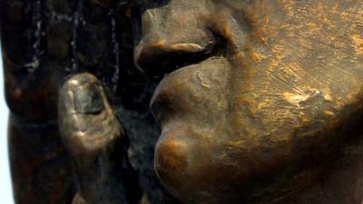 Foto van een bronzen beeld | Archief EHF