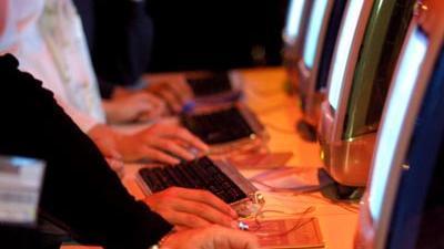 Foto van hackers achter de computer | Archief EHF