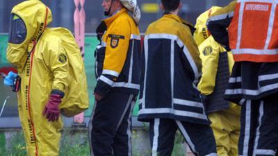 Foto van brandweer in gaspak | Archief EHF