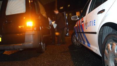 Foto van lijkwagen en politieauto | Archief EHF