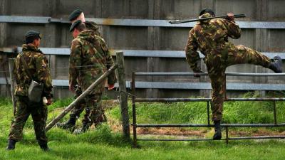 Foto van militairen in weiland | Archief EHF