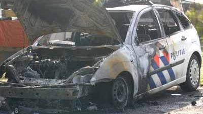 Foto van uitgebrande politieauto   Archief EHF
