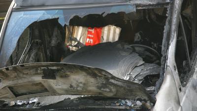 Foto van uitgebrand politiebusje | Archief EHF