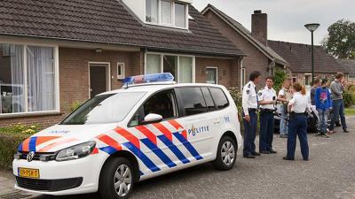 Foto van politie auto woning | Sander van Gils | www.persburosandervangils.nl
