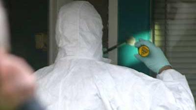 Foto van forensisch onderzoek rond woning | Archief EHF