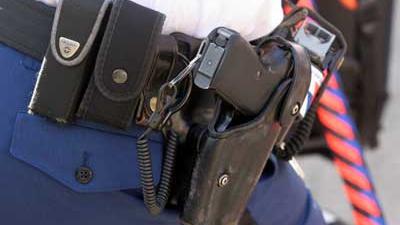 Foto van politie dienstwapen   Archief EHF