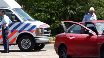 Foto van politie bij gestolen auto | Archief EHF