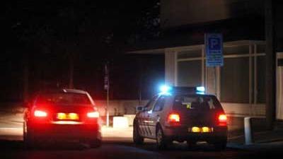 Foto van politieauto zwaailicht donker | Archief EHF